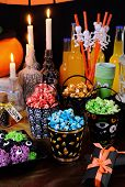 Sweet Colored Popcorn On The Table Among Halloween Sweetness. poster