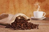 Coffee Beans And Burlap Sack - Roasted Coffee Beans Spilling From A Burlap Sack, Cup Of Coffee With  poster