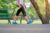Young Fitness Woman Legs Walking In The Park Outdoor, Female Runner Running On The Road Outside, Asi poster