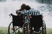 Disabled People On Wheelchairs Near Lake In Park. Disabled Young Man. Woman On Wheelchair. Relaxing  poster