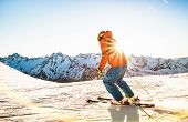 Professional Skier Athlete Skiing At Sunset On Top Of French Alps Ski Resort - Winter Vacation And S poster