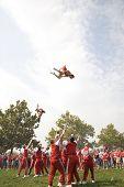 Cheerleading stunt by Ohio State cheerleaders