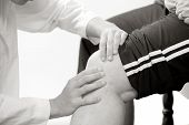 physical therapist checks a knee joint