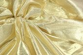 Gold lame fabric background