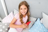 Activities For Pajama Party. Girl Kid Wear Pajama Hold Smartphone. Child In Pajama Hold Smartphone.  poster