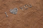 I Love You Picture From Pebble And Sand On A Beach. Love You Background poster