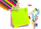 Colored Pencil, Clips And Note Paper On White