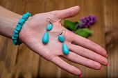Bracelet And Earrings Of Turquoise On A Womans Palm. poster