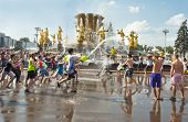 MOSCOW, RUSSIA - JULY 3: young people shooting and throwing water at each other during Water Wars fl