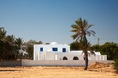 White house in arabic style on Djerba, Tunisia