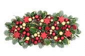 Christmas and winter table decoration with red and gold bauble decorations, holly berries, spruce pi poster