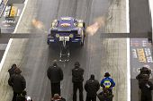 CONCORD, NC - MAR 28:  Ron Capps brings his NAPA Funny Car down the track at the zMax Dragway for th