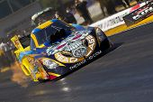 GAINESVILLE, FL - MAR 11:  Driver, Jim Head, brings his Funny Car race car down the track during a q
