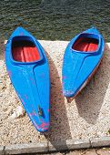 blue and red  canoes (big and small)
