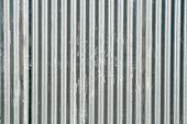 Corrugated fence background.
