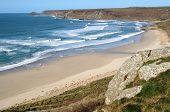 Atlantic waves reaching the beach at Sennen Cove, Cornwall, UK