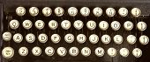 The keys of an old dirty typewriter.