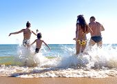 Happy Young Family Have Fun And Live Healthy Lifestyle On Beach.friendship, Sea, Summer Vacation, Ho poster