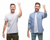 Collage of young man wearing casual look over white isolated backgroud angry and mad raising fist fr poster