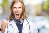 Young handsome doctor man with long hair over isolated background angry and mad raising fist frustra poster