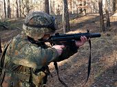 foto of hider  - Soldier aiming the target in the woodland - JPG