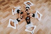 Ballet Training Of Group Of Young Girls On Floor. Classical Ballet. Girl In Balerina Tutu. Training  poster