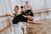 Ballet Training Of Group Of Girls With Teacher. Classical Ballet. Girl In Balerina Tutu. Training In poster