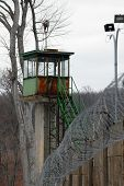 Abandoned guard tower on a prison wall