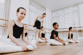 Ballet Training Of Girls On Floor With Teacher. Classical Ballet. Girl In Balerina Tutu. Training In poster