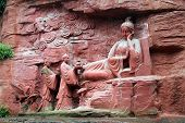 stock photo of emei  - Buddhist goddes near the wall of rock in Emei SDhan China - JPG