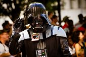 A Star Wars fan dressed as Darth Vader marches in the annual DragonCon parade