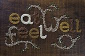 The Phrase 'eat Well, Be Well', Written And Decorated In Seeds