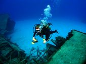 Diver Photographing A Sunken Shipwreck