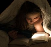 Child Reading In The Dark