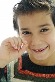 image of tooth-fairy  - Portrait of cute kid losing his first tooth - JPG