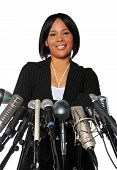 picture of public speaking  - African American Woman behind microphones isolated over a white background - JPG