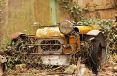picture of car carrier  - Old forgotten car rusting at the backyard of an old english property - JPG
