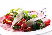 Beef carpaccio served with ruccola and mushroom