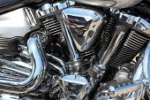 pic of exhaust pipes  - Closeup of chromed motorcycle engine - JPG