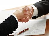 stock photo of pen  - Handshake of business partners - JPG