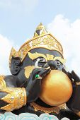 Phra Rahu Statue, Who Is The Mythical God Of Darkness, Located In Public Temple Of Thailand