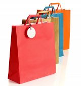 Assorted colored shopping bags over white background