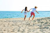 Children Couple Running On Beach.