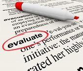 The word Evaluate circled in a dictionary giving a definition of feedback, assessment, review, ratin