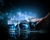 picture of fumes  - Three glasses of blue cocktail with fume going out - JPG