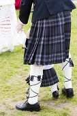 stock photo of kilt  - detail of man and child wearing kilt - JPG