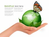 stock photo of leaf insect  - Green world with leaf and butterfly in woman hand - JPG