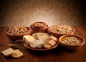 foto of carbohydrate  - Whole grain carbohydrates on wooden table with studio lighting - JPG