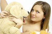 Happy Cute Blond Woman With Stuffed Toy Dog