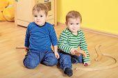 Cute european toddlers in kindergarten.